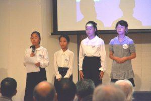 会議の成果を報告する旭小の児童